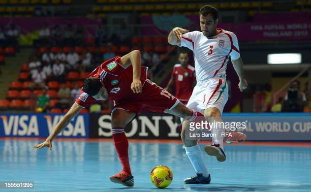 Yahya Jabrane of Morocco is challenged by Ali Rahnama of Iran during the FIFA Futsal World Cup Group B match between Morocco and Iran at Indoor...