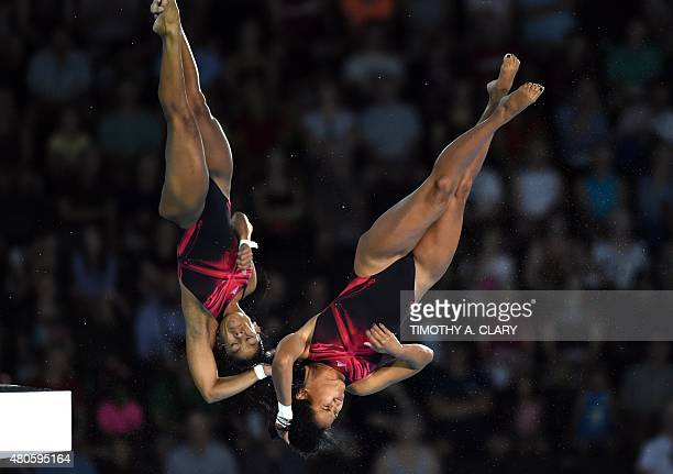 Yaima Mena and Annia Rivera of Cuba compete during the Women's Synchonised 10m Platform Finals at the Toronto 2015 Pan American Games in Toronto...