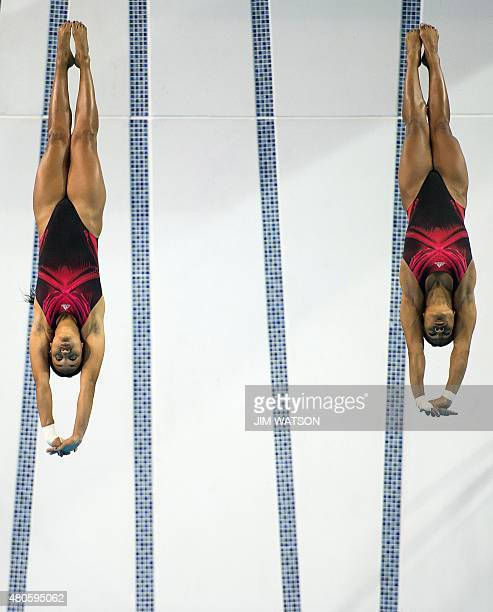 Yaima Mena and Annia Rivera of Cuba compete in the Women's Synchronized 10M Platform finals at the 2015 Pan American Games in Toronto Canada July 13...