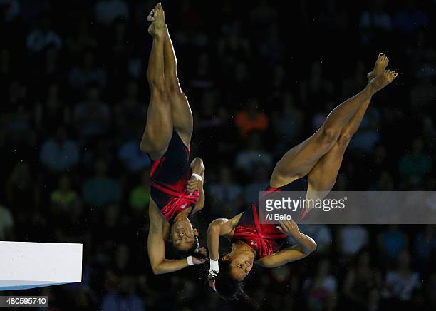Yaima Mena and Annia Rivera of Cuba dive at the Pan Am Games during the Women' Synchronised 10m Platform Final at the Pan Am Games on July 13 2015 in...