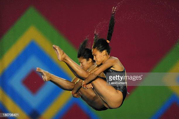 Yaima Rivera Mena and Annia Cuba in the final women's 10m synchronized diving at the 2011 Pan American Games at the Aquatic Center Scotiabank on 27...