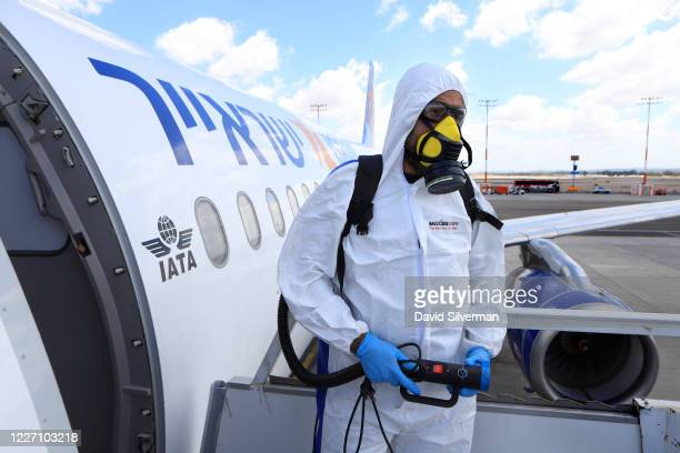 Yair Badash a maintenance manager at the Israeli lowcost ariline Israir wears his PPE as he prepares to disinfect an aircraft between flights at Ben...