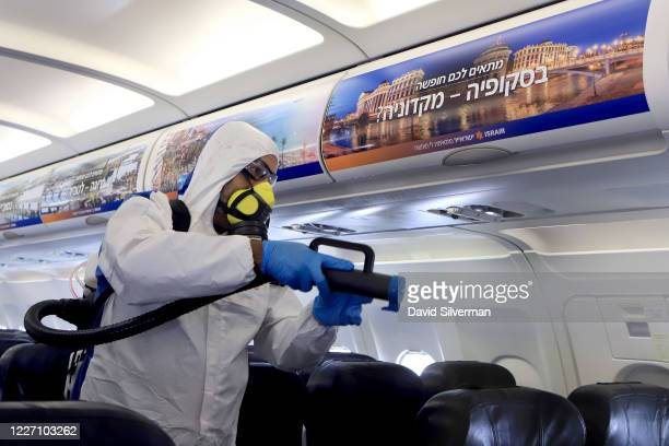 Yair Badash a maintenance manager at the Israeli lowcost ariline Israir wears his PPE as he disinfects an aircraft between flights at Ben Gurion...