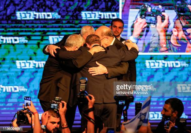 TOPSHOT Yair Lapid Benny Gantz Moshe Yaalon and Gabi Ashkenazi of the Blue and White political alliance huddle together as they appear before...