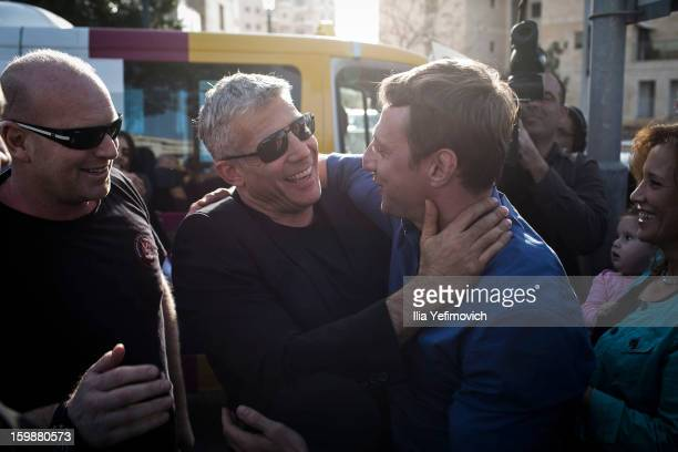 Yair Lapid chairman of 'Yesh Atid' party meets a supporter as he visits a polling station to cast his vote in the Israeli General Election on January...