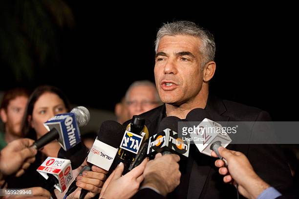 Yair Lapid leader of the Yesh Atid party speaks to members of the press outside his house following his unexpectedly strong showing in this week's...