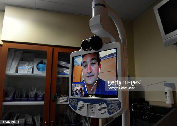 Yair Lurie an Intouch Health product specialist seen on the screen talks about the telemedicine robot device from his location in Santa Barbara CA...