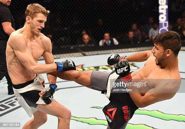 Yair Rodriguez kicks Dan Hooker in their featherweight bout during the UFC 192 event at the Toyota Center on October 3 2015 in Houston Texas