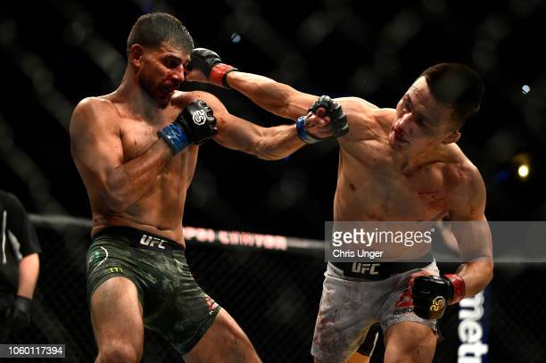 Yair Rodriguez of Mexico and Chan Sung Jung of South Korea exchange punches in their featherweight bout during the UFC Fight Night event inside Pepsi...