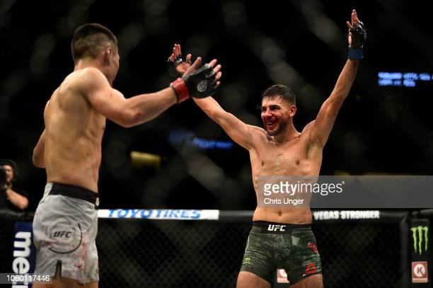 Yair Rodriguez of Mexico and Chan Sung Jung of South Korea react in the fifth round in their featherweight bout during the UFC Fight Night event...