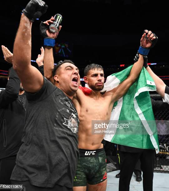 Yair Rodriguez of Mexico celebrates with his corner after defeating Chan Sung Jung of South Korea by knock out in the fifth round in their...