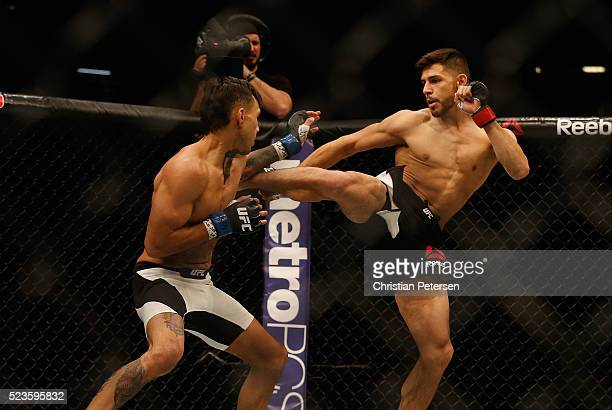 Yair Rodriguez of Mexico kicks Andre Fili in their featherweight bout during the UFC 197 event inside MGM Grand Garden Arena on April 23 2016 in Las...