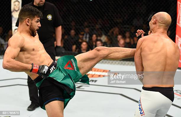 Yair Rodriguez of Mexico kicks BJ Penn in their featherweight bout during the UFC Fight Night event inside Talking Stick Resort Arena on January 15,...
