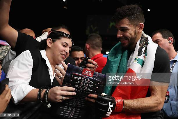 Yair Rodriguez poses with fans after his victory over BJ Penn during the UFC Fight Night event at the at Talking Stick Resort Arena on January 15...