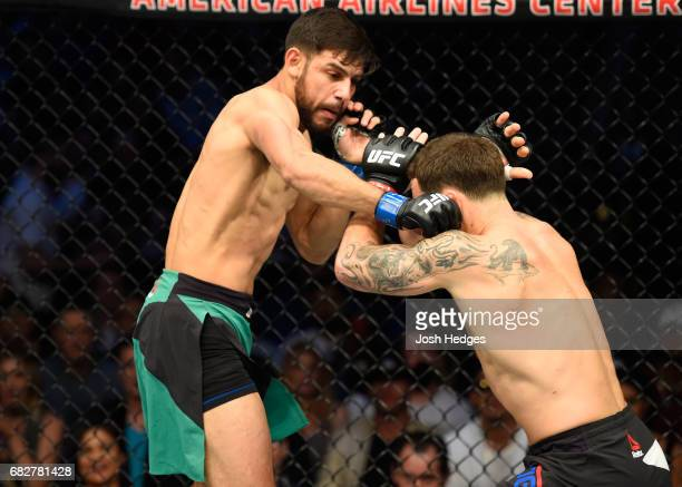 Yair Rodriguez punches Frankie Edgar in their featherweight fight during the UFC 211 event at the American Airlines Center on May 13 2017 in Dallas...