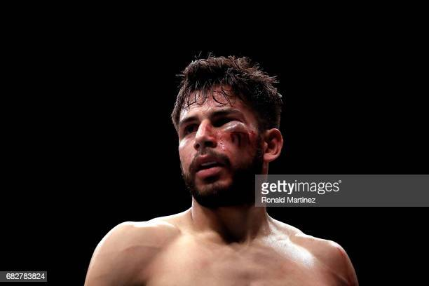 Yair Rodriguez suffers a cut under the eye during his Featherweight bout against Frankie Edgar during UFC 211 at American Airlines Center on May 13...