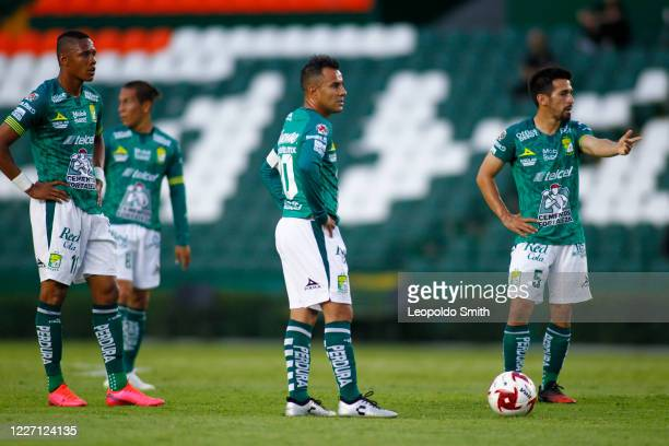 Yairo Moreno Luis Montes and Fernando Navarro of Leon prepare for a free kick during a match between Leon and FC Juarez as part of the friendly...
