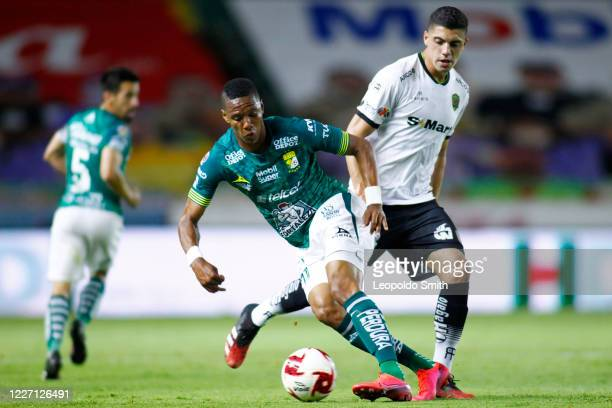 Yairo Moreno of Leon competes for the ball against Brian Rubio of FC Juarez during a match between Leon and FC Juarez as part of the friendly...
