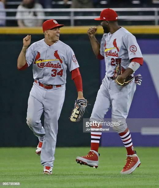 Yairo Munoz and Dexter Fowler of the St Louis Cardinals celebrate a win over the Chicago White Sox at Guaranteed Rate Field on July 10 2018 in...