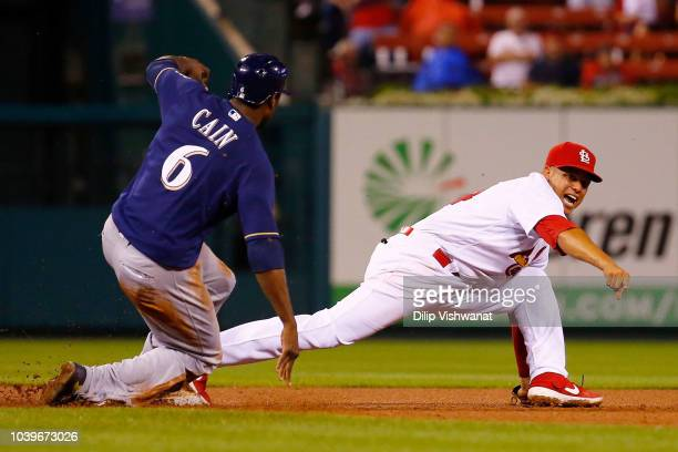Yairo Munoz of the St Louis Cardinals beats Lorenzo Cain of the Milwaukee Brewers to second base for an out in the seventh inning at Busch Stadium on...