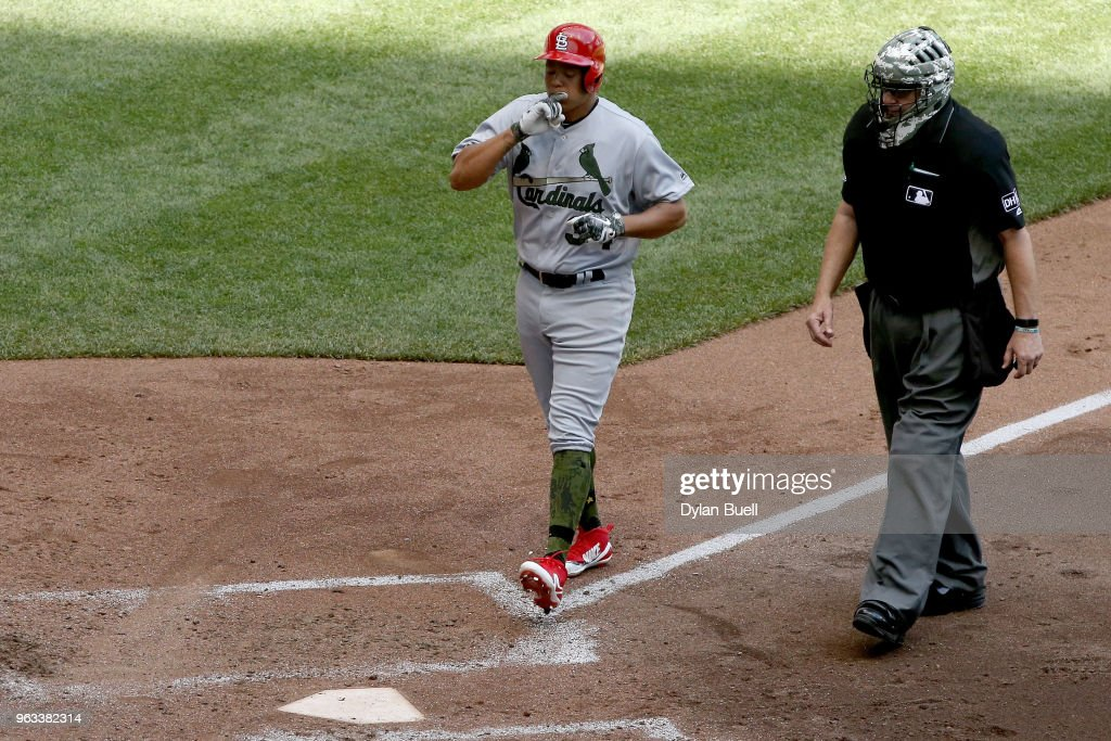 Yairo Munoz #34 of the St. Louis Cardinals crosses home plate after his first career home run in the fifth inning against the Milwaukee Brewers at Miller Park on May 28, 2018 in Milwaukee, Wisconsin. MLB players across the league are wearing special uniforms to commemorate Memorial Day.