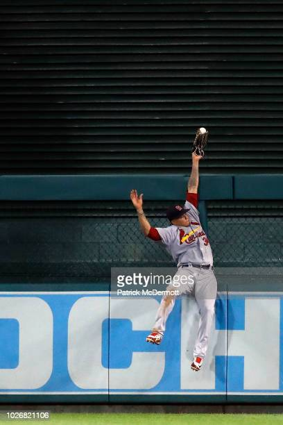 Yairo Munoz of the St Louis Cardinals is unable to catch an tworun RBI double hit by Ryan Zimmerman of the Washington Nationals in the ninth inning...