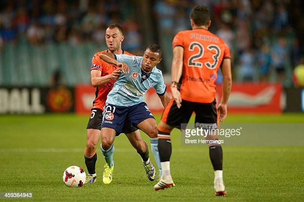 Yairo Yau of Sydney is tackled by Ivan Franjic of the Roar during the round 12 ALeague match between Sydney FC and Brisbane Roar at Allianz Stadium...