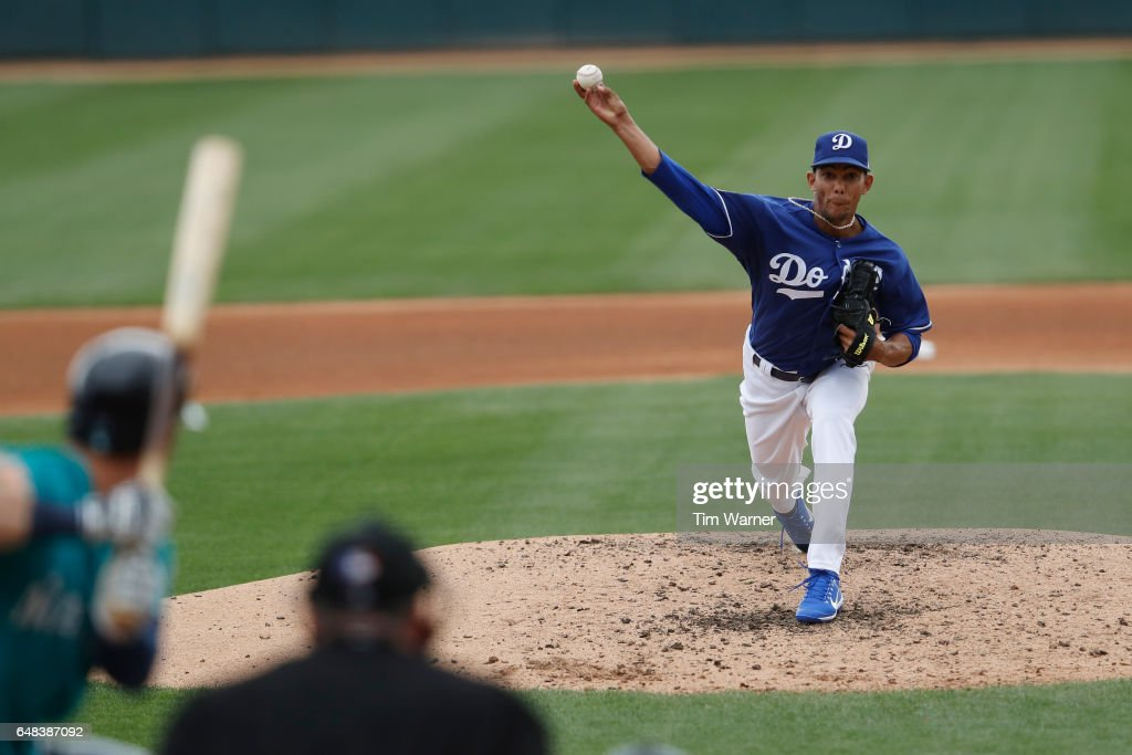 Yaisel Sierra #81 of the Los Angeles Dodgers pitches in the fourth inning against the Seattle Mariners during the spring training game at Camelback Ranch on March 5, 2017 in Glendale, Arizona.