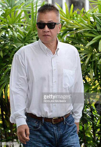 Yak Yew Chee a former managing director of the Singapore branch of Swiss bank BSI arrives at the State court in Singapore on November 11 2016 Yak a...