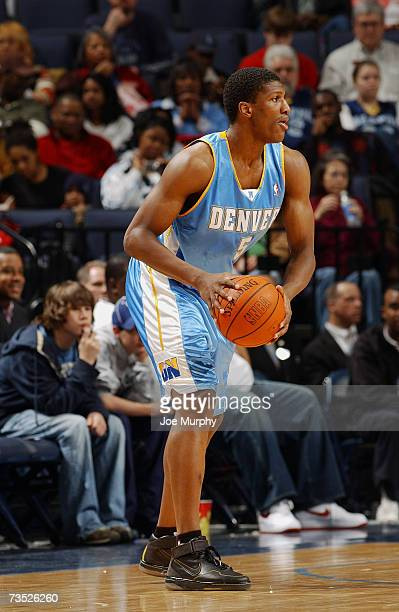 Yakhouba Diawara of the Denver Nuggets looks to move the ball against the Memphis Grizzlies during the game at FedExForum on February 26, 2007 in...