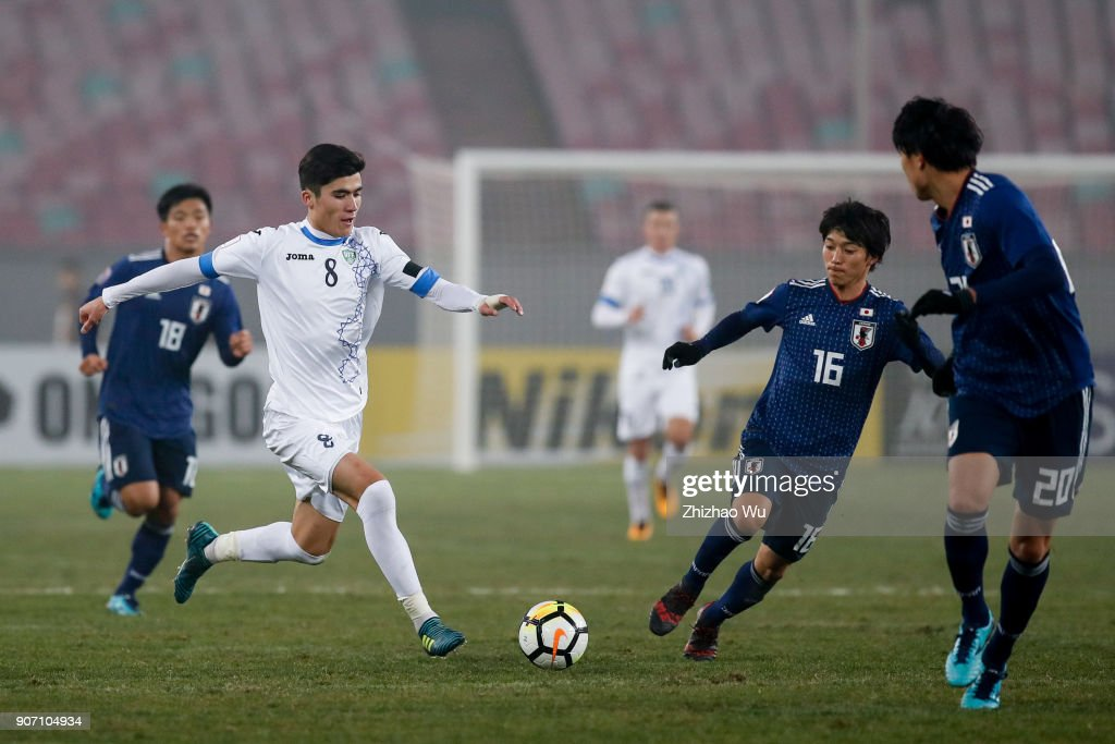#8 Yakhshiboev Jasurbek of Uzbekistan in action during AFC U23 Championship Quarter-final between Japan and Uzbekistan at Jiangyin Sports Center on January 19, 2018 in Jiangyin, China.