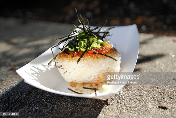 Yakionigiri is a grilled rice ball with pork miso filling soy miso glaze nori and scallions at Mami Japanese food truck in Congress Square in...