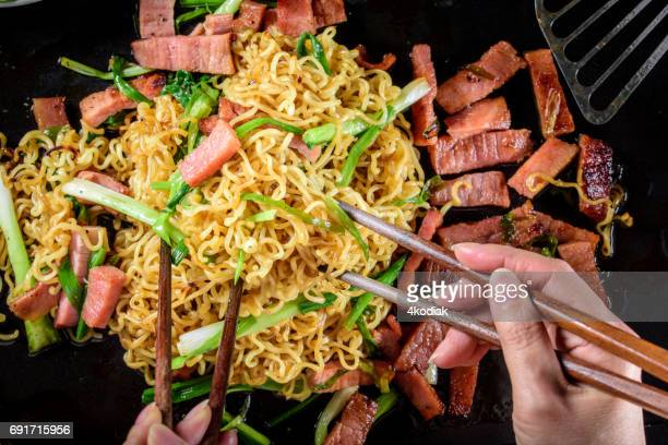 Yakisoba, Japanese Pan Fried Noodle, with Ham and Scallion in Cast Iron Pot