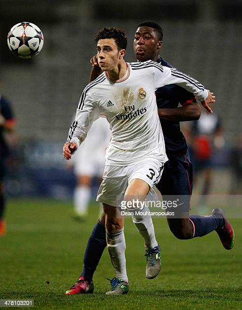 Yakou Meite of PSG and Mario Hermoso Canseco of Real Madrid battle for the ball during the UEFA Youth League Quarter Final match between Paris...