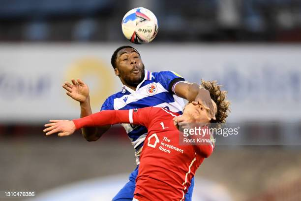 Yakou Meite of Reading battles for a header with Callum Styles of Barnsley during the Sky Bet Championship match between Barnsley and Reading at...