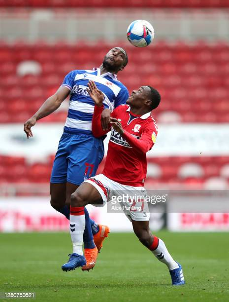 Yakou Meite of Reading FC and Marc Bola of Middlesbrough battle for the ball during the Sky Bet Championship match between Middlesbrough and Reading...