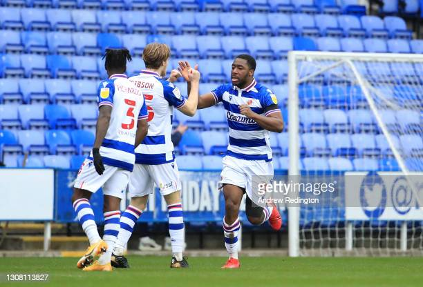 Yakou Meite of Reading FC celebrates with Lewis Gibson after scoring their team's first goal during the Sky Bet Championship match between Reading...
