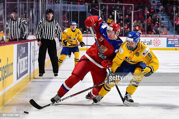 Yakov Trenin of Team Russia and Rasmus Dahlin of Team Sweden chase after the puck during the 2017 IIHF World Junior Championship bronze medal game at...