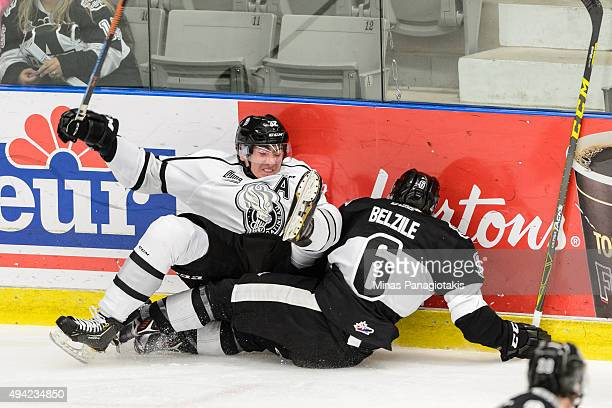 Yakov Trenin of the Gatineau Olympiques falls onto of Antoine CreteBelzile of the BlainvilleBoisbriand Armada during the QMJHL game at the Centre...