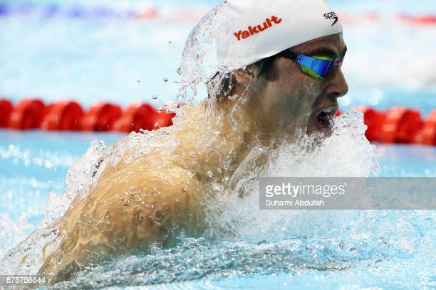 Yakov Yan Toumarkin of Israel competes in the men's 100m Individual Medley final during the FINA Swimming World Cup at OCBC Aquatic Centre on...