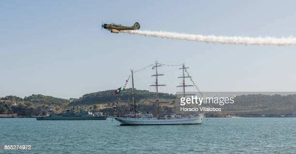 Yakovlev Yak52 performs aerobatics over Tagus River during the commemoration of the 100th anniversary of Portuguese Naval Aviation on September 28...