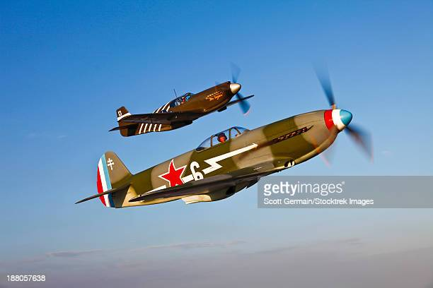 A Yakovlev Yak-9 fighter plane and a North American P-51A Mustang in flight near Chino, California.