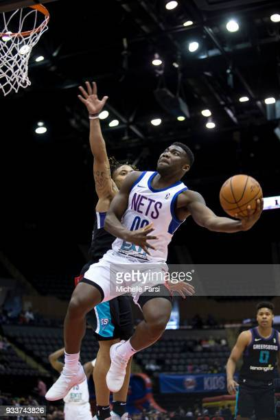 Yakuba Ouattara of the Long Island Nets goes to the basket against the Greensboro Swarm on March 18 2018 at NYCB Live Home of the Nassau Veterans...