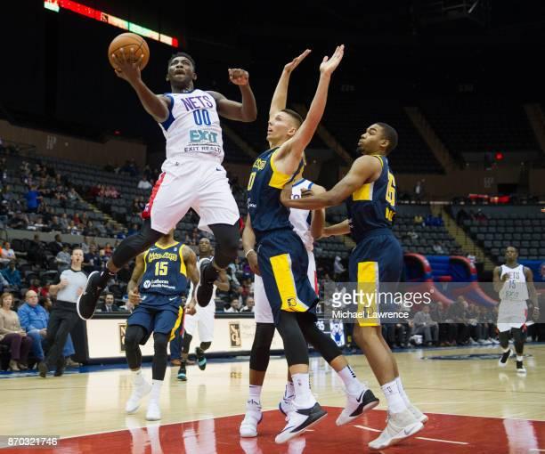 Yakuba Ouattara of the Long Island Nets Jarrod Uthoff of the Fort Wayne Mad Ants Ben Moore of the Fort Wayne Mad Ants during an NBA GLeague game on...