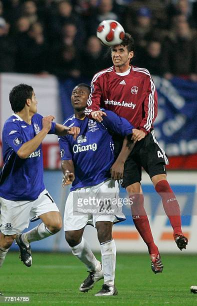 Yakubu Ayegbeni of Everton and Glauber of Nuremberg battle for the ball during the UEFA Cup Group A match between 1. FC Nuremberg and FC Everton at...