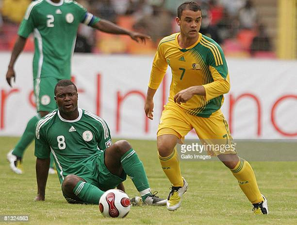 Yakubu Ayegbeni of Nigeria and Lance Davids of South Africa in action during the AFCON and 2010 World Cup Qualifier between Nigeria and South Africa...