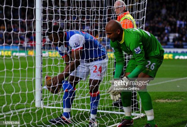 Yakubu of Blackburn Rovers and Ali Al Habsi of Wigan Athletic remove a chicken from the goal during the Barclays Premier League match between...