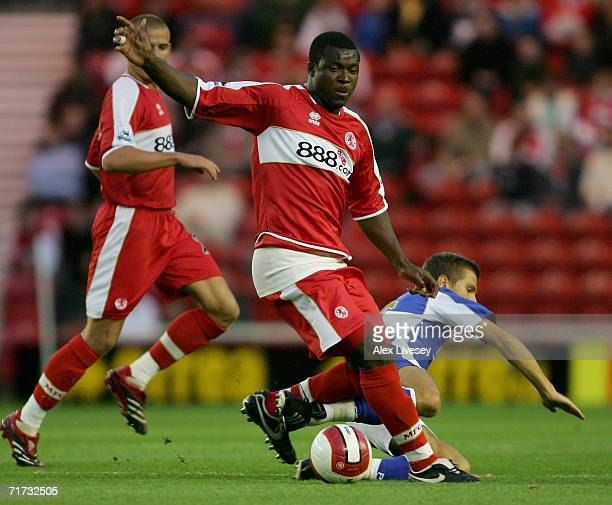Yakubu of Middlesbrough is tackled by Gary O'Neil of Portsmouth during the Barclays Premiership match between Middlesbrough and Portsmouth at the...