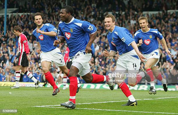Yakubu of Portsmouth celebrates scoring from the penalty spot with teammates Patrick Berger Matthew Taylor and Gary O'Neil during the Barclays...