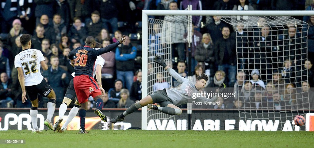 Yakubu of Reading scores their second goal during the FA Cup fifth round tie between Derby County and Reading at iPro Stadium on February 14, 2015 in Derby, England.